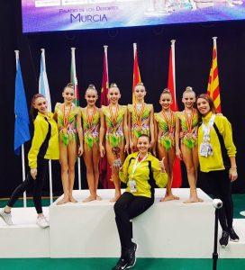 podium-con-entrenadoras